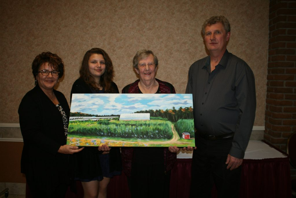 Charlene, Danielle, Stella & Lindon Mullen received a painting of their farm as part of the 2016 EFP Stewardship Award. The painting this year was done by Susan Sweet